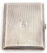 Continental white metal cigarette case of rectangular hinged form, engine turned with linear