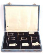 Unusual cased set of six silver plated sandwich flags with slot-in sandwich names