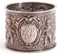Late Victorian Scottish napkin ring, well embossed with putti, quiver and torches etc, 5cm diam,