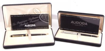 Two modern cased Aurora fountain pens, the first with black lacquered case and gilt fittings, the