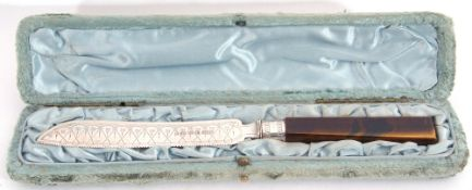 Victorian silver wedding cake knife, the blade has detailed engraving on one side with a serrated