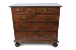 Late 17th/early 18th century walnut chest, the inlaid top over two short and three full width