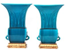 Pair of Theodore Deck blue faience vases of archaic Chinese form decorated with a geometric