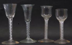 Group of 4 mid 18th century wine glasses, all with opaque/air twist stems, (4)