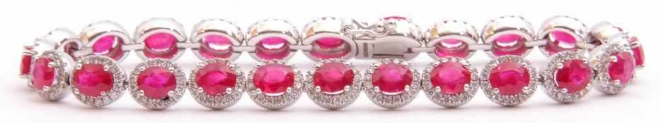 Ruby and diamond set line bracelet featuring 24 oval faceted rubies, each raised within a small
