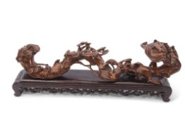 Chinese root carving on black wooden mount, 48cm long