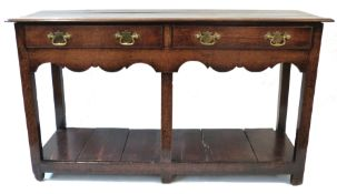 18th century oak small dresser base, plain plank top over two frieze drawers and raised on plain