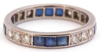 Precious metal, sapphire and diamond full eternity ring, alternate set with three calibre cut square