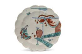 An 18th century Chelsea plate of lobed form decorated in the Kakiemon palette with the lady in