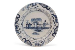 Mid-18th century Bristol Delft charger decorated with a chinoiserie design of a figure against a