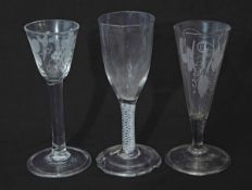 Fluted glass with engraved leaf decoration, a further air twist and a wine glass with grape