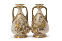 Pair of Royal Worcester aesthetic style vases, the white body with gilt prunus and floral decoration