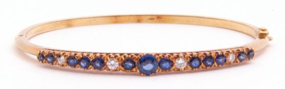 Sapphire and diamond hinged bracelet, the raised pierced gallery set with 13 round faceted sapphires