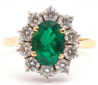 Emerald and diamond cluster ring, the oval faceted cut emerald 1.14ct approx, set within a