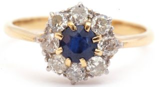 Sapphire and diamond cluster ring, the round cut faceted sapphire 5mm diam, multi-claw set and