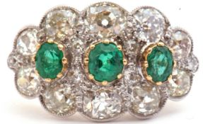 Large emerald and diamond cluster ring of oval design, featuring three graduated oval faceted