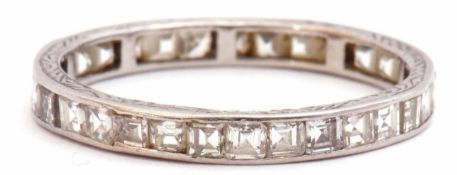 Precious metal and diamond set full eternity ring, a continuous band of small pave set square cut