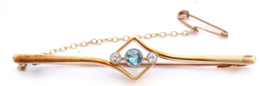 Aquamarine and diamond set bar brooch, the centre an offset square frame featuring a round faceted