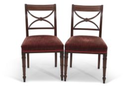 Set of 8 Regency period mahogany bar back dining chairs with X-frame splats over pink upholstered