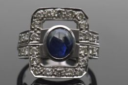 Sapphire and diamond dress ring, the carved open work rectangular panel centring an oval sapphire