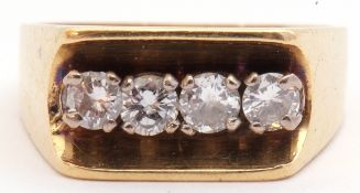 18ct gold and four-stone diamond ring of angular design, the central groove shaped gallery featuring