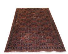 Late 20th century Caucasian carpet, all over geometric lozenge decoration within triple gull border,