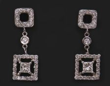 Pair of diamond cluster pendant earrings, each set with a Princess cut diamond, 0.86ct total, colour