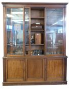 19th century mahogany library bookcase, by W H Travers, the glazed top with fitted adjustable