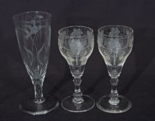 Pair of 18th century style wine glasses, finely engraved with fruiting vines above a double