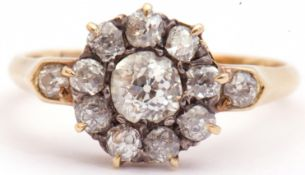 Antique diamond cluster ring, the principle old cut diamond 0.40ct approx, within a surround of
