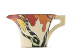 Daffodil shaped jug with the Honolulu design by Clarice Cliff, decorated in typical colours and