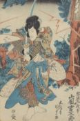 Group of three woodblock prints, probably by Kunisada, a study of a warrior held ready to strike a
