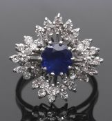 Sapphire and diamond cluster ring, a snowflake design centring a round cut faceted sapphire (7mm