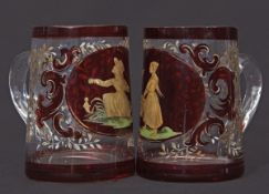 Two small glass tankards decorated in gilt with a young girl feeding birds, the other with a similar