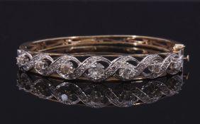 Diamond set hinged bracelet, featuring seven round graduated Victorian cut diamonds, 3.0ct approx,