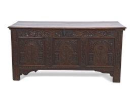 18th century oak coffer, two plank top over a three panel front carved with rosettes and arcaded