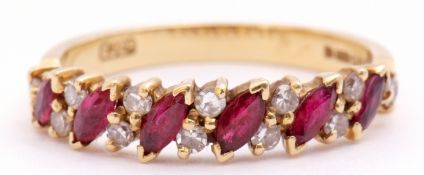 An 18ct gold, ruby and diamond ring, alternate set with angled lozenge shaped rubies and pairs of