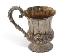 George IV campana shaped half pint mug with wavy rim, gilt interior, embossed with convolvulus and