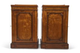 Pair of Gillows satinwood cabinets, the tray tops inlaid with geometric ebonised stringing over