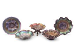 Dugan carnival glass blue plate in the apple blossom and twigs pattern, a Northwood amethyst three-