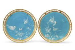 Pair of 19th century Minton plates with enamel decoration of birds on a turquoise ground within