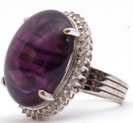 Large amethyst and diamond dress ring, the large oval shaped cabochon 24mm x 24mm, four claw set and