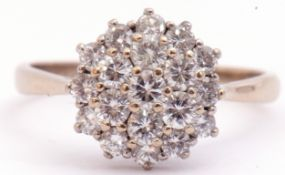 Diamond cluster ring set with 19 small diamonds in a three tier cluster design, diamond weight