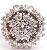 18ct white gold and diamond cluster ring, the pierced panel with a brilliant cut diamond flower head