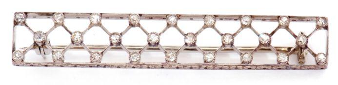 Diamond set brooch of elongated rectangular pierced form with a lattice work design, highlighted