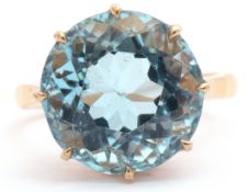 Mid 20th century aquamarine single stone ring of circular faceted shape, multi-claw set, 14.18mm