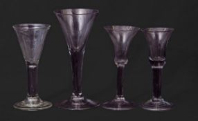 Four 18th century glasses including two with bell shaped bowls, one with funnel bowl and a small