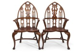 Set of five unusual Windsor chairs, the yew tops with lancet shaped backs and pierced central