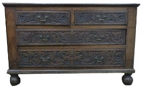 Oak large chest of rectangular form, two foliate moulded short drawers and two further full width