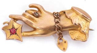 Victorian 9ct gold, ruby and diamond brooch, a design with an outstretched hand holding a flower set